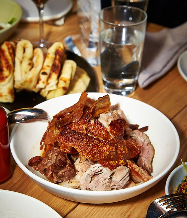 **** Sasi's wood-roasted whole hog with all the trimmings.