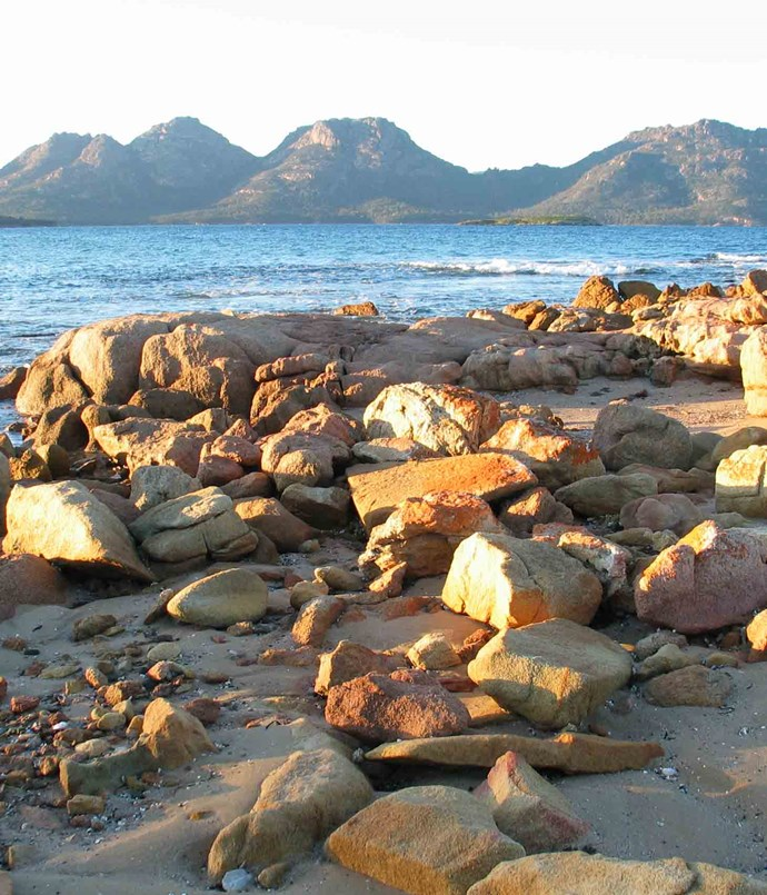 **Hobart: East Coast** Tasmania's scenic [eastern seaboard](http://www.discovertasmania.com.au) is a long, ragged strip of peninsulas, islands, channels and windswept beaches, flanked by rugged mountains enclosing gorges, waterfalls and forests. One minute you are driving through bucolic farmland and quaint convict-built villages or along the course of a twisting, shallow river, and the next you find yourself in dense, lush rainforest. The drive from Hobart to The Bay of Fires in the northeastern takes approximately three hours.