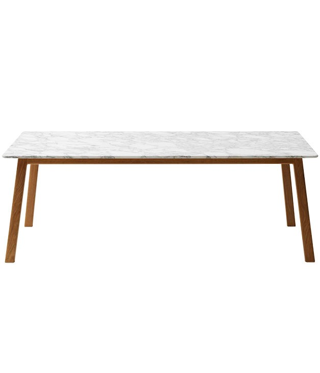 "**Jardan dining table** ""I love the combination of textures in this table, with its marble top and wooden base; it's a little beachy but still sophisticated. I also really like the wear and tear that the marble shows; it feels loved and used. It's really great for rolling out pastry, too. It was a major investment, but one I'm so pleased I made."" American oak base/Carrara top ""Navy"" table, $6257 (length 210cm), from [Jardan](http://www.jardan.com.au ""Jardan"")."