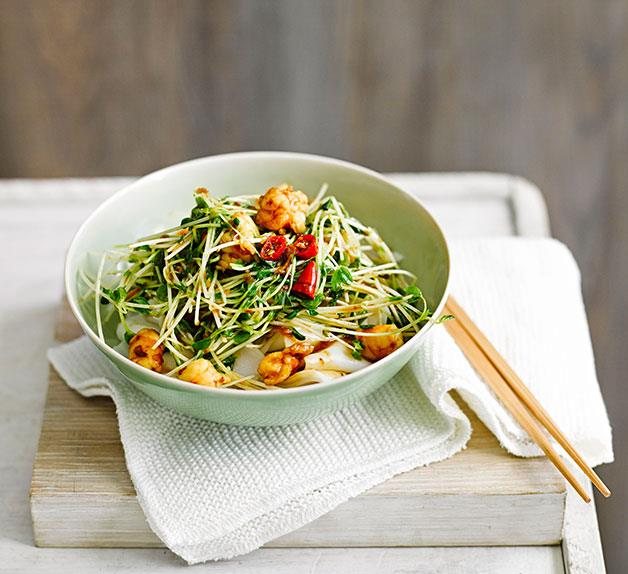 Rice noodles with snow pea sprouts and prawns