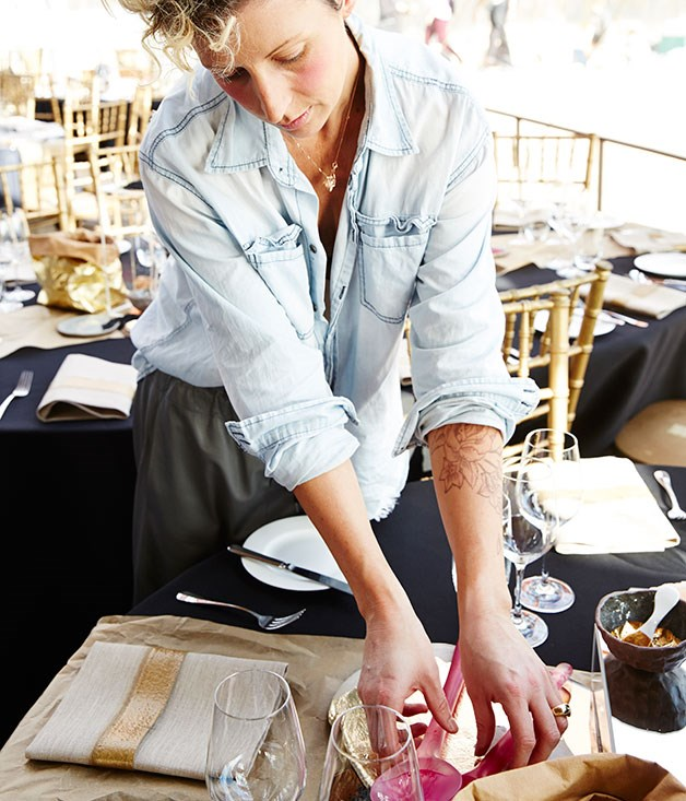 **** Stylist Jane Frosh of Cool Edies setting up the tables.