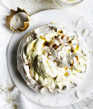 Coconut pavlova with passionfruit jam and lychees