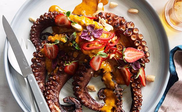 Coal-grilled octopus with smoked butter and almonds, chilli and green strawberries