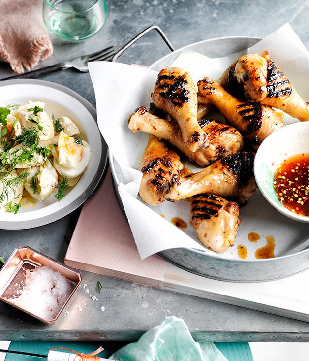 Southern barbecue chicken drumsticks with mop sauce and potato salad