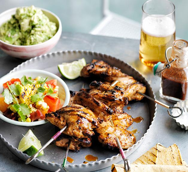 Smoky chilli chicken with barbecued corn, crushed avocado and soft tacos