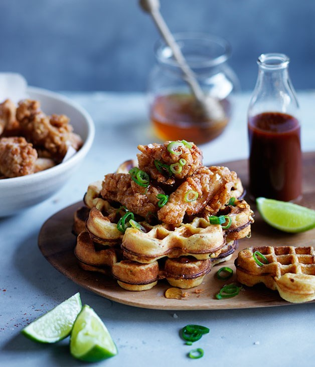 **Spicy Cornmeal Waffles with Popcorn Chicken, Honey and Hot Sauce**