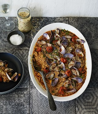 Fregola with pipis and cherry tomatoes