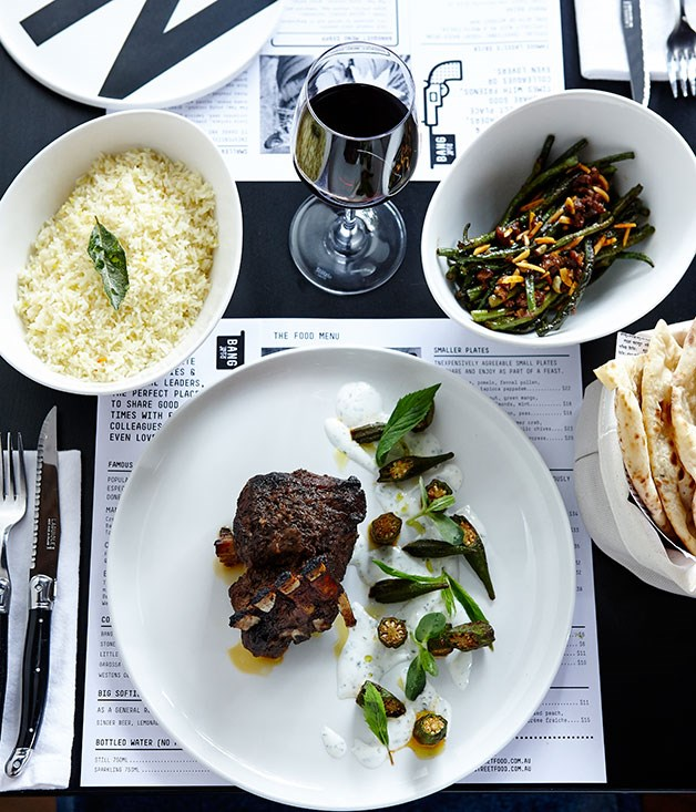 Lamb shoulder blade, okra, mint yoghurt and black salt accompanied by snake beans, sultanas and almonds, and naan bread