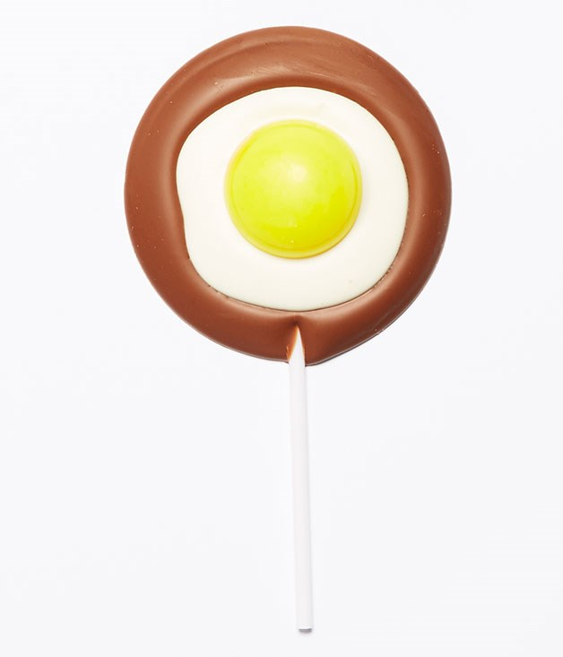 "**Chocolate ""Fried Egg"" Lollipop** These playful chocolate lollipops from [Burch & Purchese](http://www.burchandpurchese.com ""Burch & Purchese"") are the perfect addition to your afternoon coffee ritual. _Milk and white chocolate lollipops, $5.50 each_"