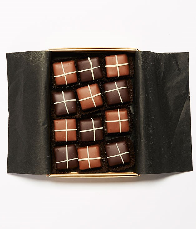 "**Choc-Cross Bun Truffles** Tired of all those bunnies and eggs? These After-Eight sized, choc-cross bun truffles from [Couverture & Co](http://www.couvertureandco.com.au ""Couverture & Co"") still have plenty of Easter spirit. _$2.50 per chocolate; 13.50 for a gift box of 4; $38 for a gift box of 12_"