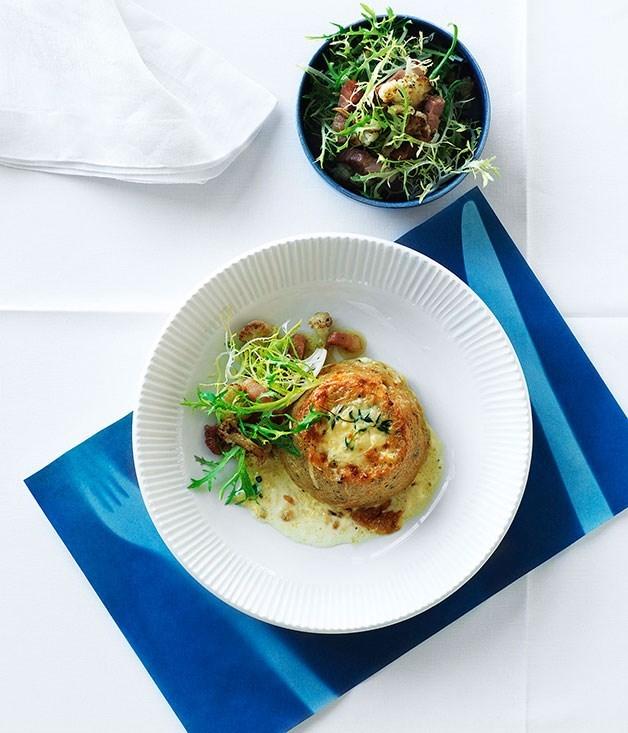 **Double-baked cauliflower and Gruyère soufflé with frisée and lardon salad**