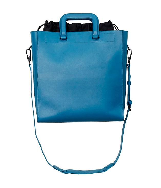 "**Philip Lim tote** This tote is the one we want. Not only is it standalone chic, it also features a sneaky and detachable drawstring backpack, which means you get two bag solutions in one fell swoop. Clever. [Phillip Lim](http://www.31philliplim.com ""Philip Lim"") teal 'Commuter' tote, $1250."
