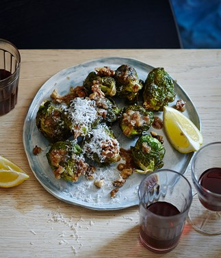 Brussels sprouts with walnut dressing, lemon and pecorino