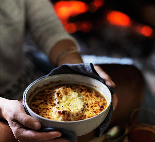 Onion and bacon soup with mustard and cheese crust