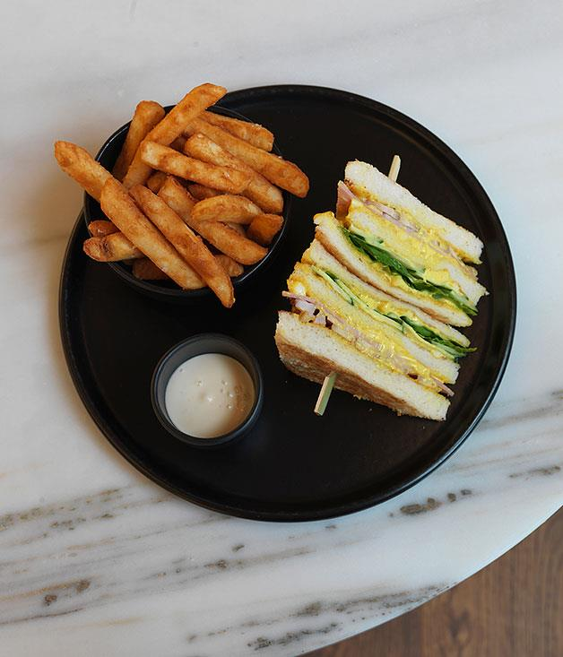 **Best Club Sandwich** We've chewed our way through dozens of triple toasties to bring you our definitive verdict of Australia's best club sandwich and, at the risk of giving one hotel too much love in one year, our vote goes to the [The Langham](http://www.langhamhotels.com) Sydney. Six white-toast triangles skewered in a row and stuffed with leg ham cut from the bone, house-smoked chicken, two layers of curried egg, lettuce leaves and cucumber, with a pot of aïoli and a bowl of dark-golden hand-cut chips. As club sandwich experiences go, it's easily a 9/10.
