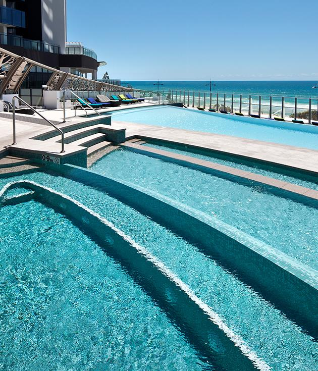 """**Best pool** This five-star self-described """"super tower"""" on the Surfers Paradise beachfront has many features in its favour, not least those vast ocean views and Seaduction restaurant. But the irresistible drawcard for holidaymakers is [Soul's](http://www.soulsurfersparadise.com.au) quartet of pools dedicated to guest pleasure. There's the alluringly tiered 25-metre outdoor pool with sweeping sightlines from Burleigh Heads to Stradbroke Island, and the 25-metre heated lap pool indoors, plus two wading pools for little swimmers. Add to that inventory heated indoor and outdoor spas, a sauna and steam room, and you'll understand why we think Soul makes the biggest splash pool-wise."""