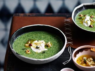 Broccoli soup with crème fraîche and hazelnuts