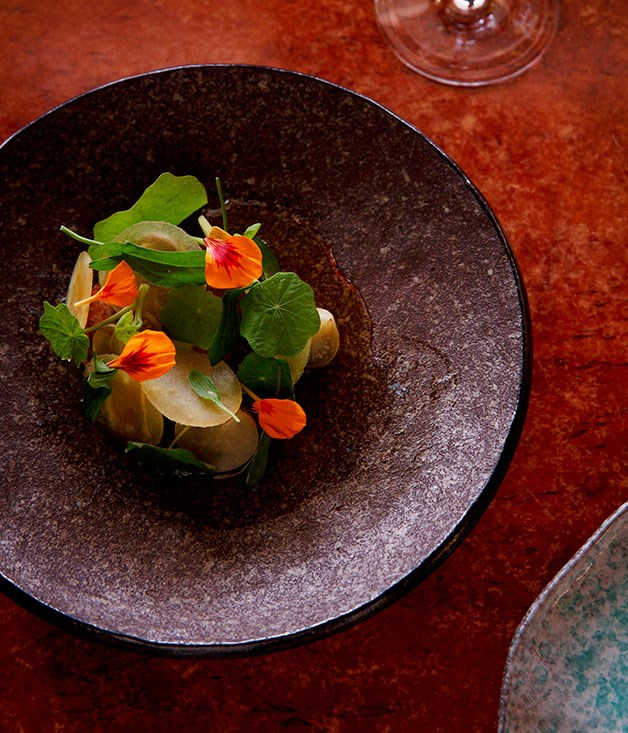 Slow-cooked pork neck with pork stock, apple and nasturtium