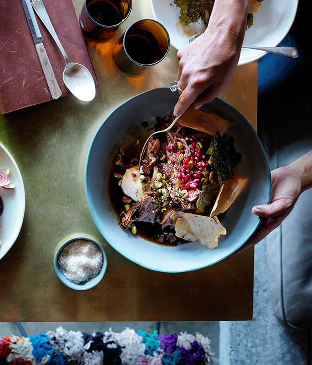 """[Slow-roasted lamb shoulder with pistachios, pomegranate and vine leaves](https://www.gourmettraveller.com.au/recipes/chefs-recipes/slow-roasted-lamb-shoulder-with-pistachios-pomegranate-and-vine-leaves-8288 target=""""_blank"""")"""
