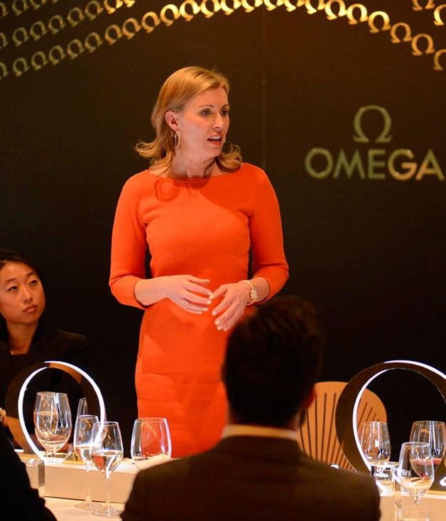 **** Omega general manager Megan Parker addresses dinner guests.