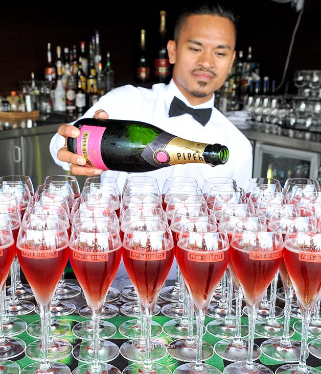**** Drinks are poured at the Piper-Heidsieck lunch at the Hamilton Island Yacht Club.