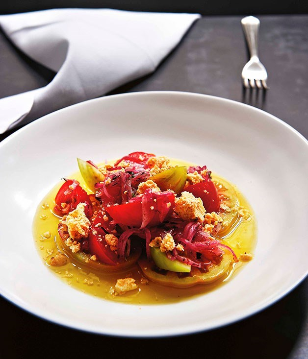 **Tomato salad with sumac, shanklish and olive oil**