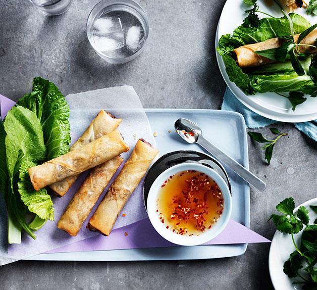 Vietnamese spring rolls with mustard leaves and herbs