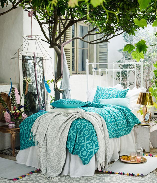 **Light and bright** Vibrant turquoise and cream bed linen.