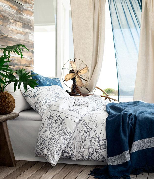 **Day dreaming** Cotton bed linen in statement prints like this white, world map style with navy throw.