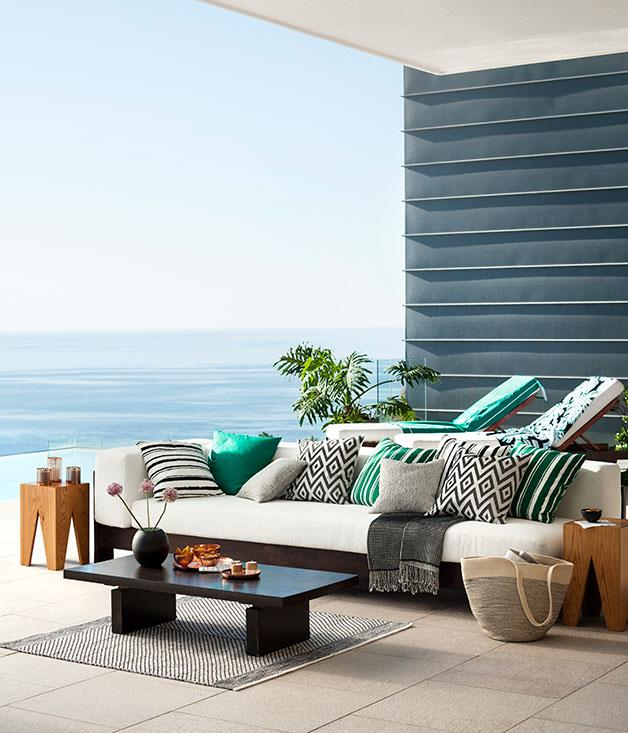 **Outdoor delights** Jacquard-weave cushions and throws in bright greens and neutrals, alongside copper candle holders.
