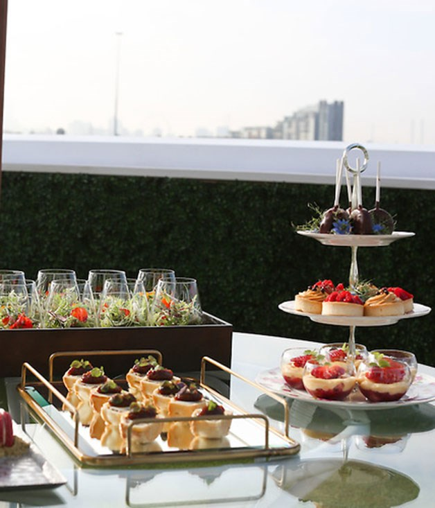 **** High tea is served on the balcony at the English-themed Emirates marquee.
