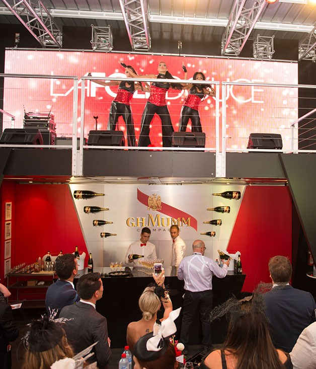 **** French performance group La Folie Douce entertain guests at the Mumm marquee.   Photo credit: SDP Media.