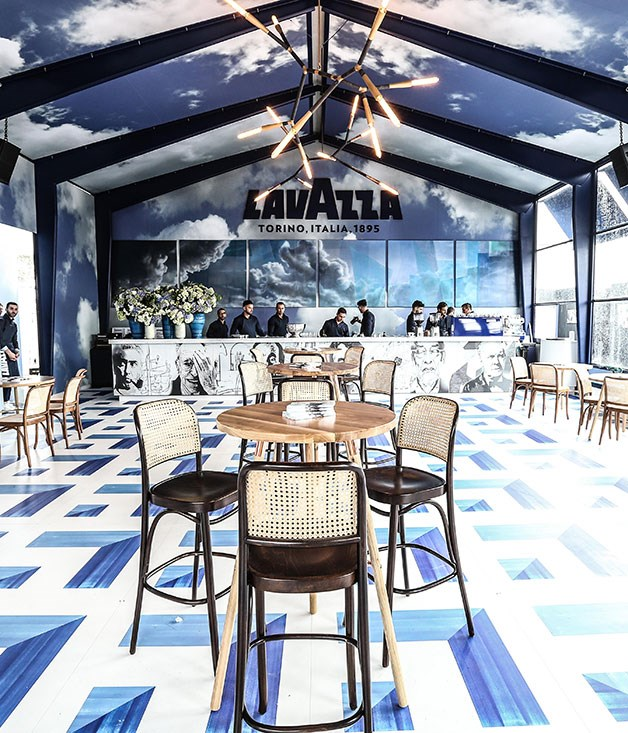 **** Lavazza celebrates 120 years with a royal blue cloud-print marquee and striking geometric floor.