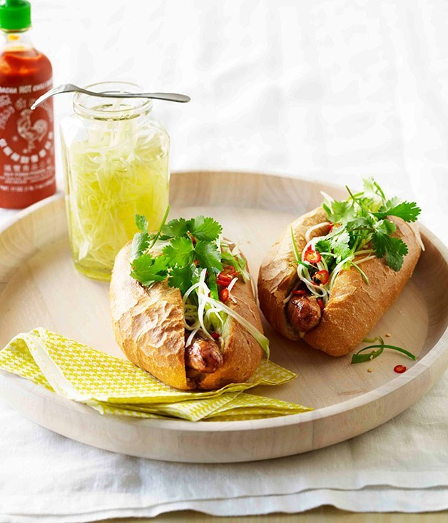 "**[Pork hot dogs with pickled green papaya](https://www.gourmettraveller.com.au/recipes/fast-recipes/pork-hot-dogs-with-pickled-green-papaya-13290|target=""_blank"")**"