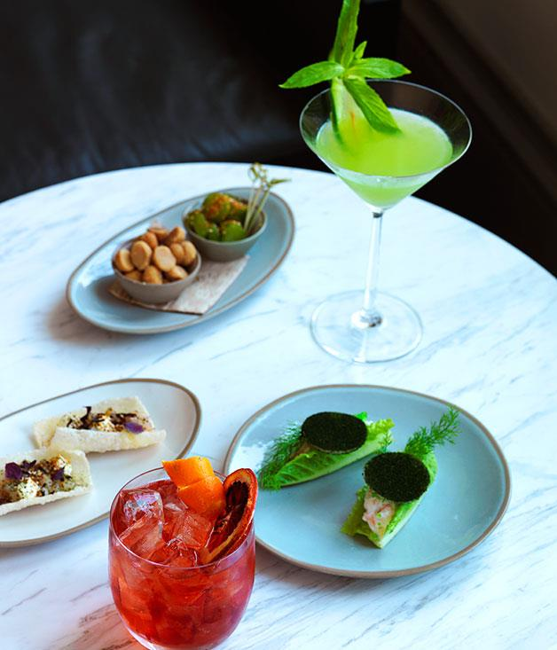 **** A Negroni Sbagliato, raw kingfish, sesame, finger lime and puffed sushi rice, olives and peanuts, a Spa Therapy cocktail, and Shark Bay prawn and avocado pudding on cos, all served in the lounge bar.