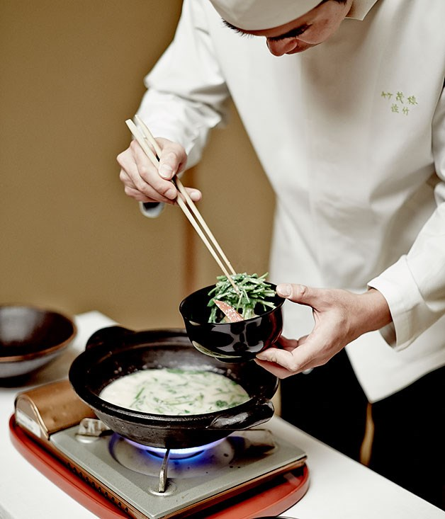 **** A chef at Takeshigero poaches fish in sake lees.