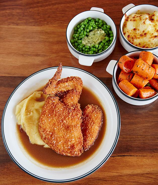 ****  Holmbrae chicken schnitzel served with mash, gravy and all the trimmings.