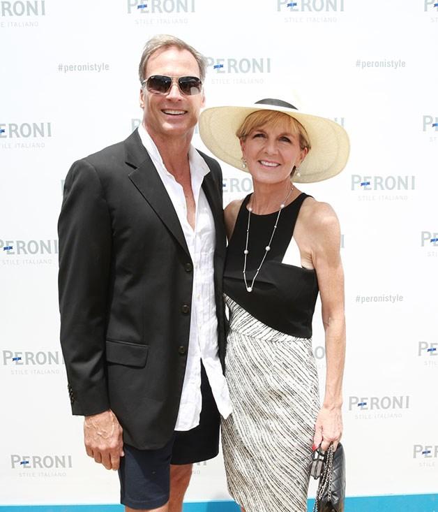 **** David Panton and Julie Bishop arrive prepared for the beautiful Melbourne sun.