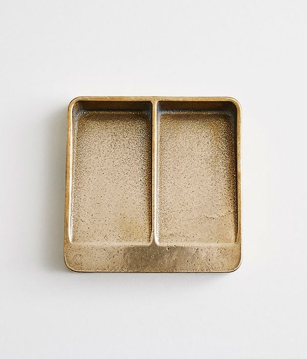 "**Henry Wilson vide poche** ""Vide poche"" means ""empty pockets"" in French, and if this [gunmetal bronze tray](http://store.henrywilson.com.au/collections/home/products/vide-poche-gunmetal-bronze ""Henry Wilson"") from Australian artist Henry Wilson ends up taking pride of place at the front door, you'll be looking for more than a few excuses to head back to your place. _$330_"