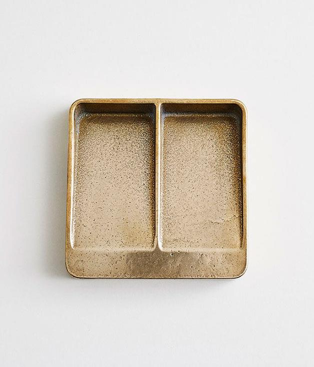 """**Henry Wilson vide poche** """"Vide poche"""" means """"empty pockets"""" in French, and if this [gunmetal bronze tray](http://store.henrywilson.com.au/collections/home/products/vide-poche-gunmetal-bronze """"Henry Wilson"""") from Australian artist Henry Wilson ends up taking pride of place at the front door, you'll be looking for more than a few excuses to head back to your place. _$330_"""