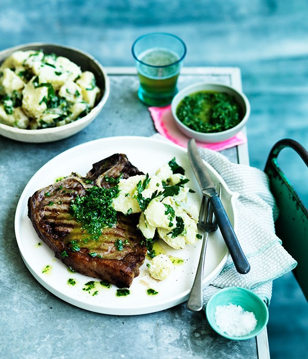Barbecued T-bones with rough rocket salsa verde and crushed potato salad