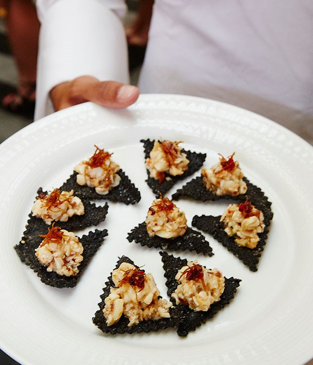 **** Lobster on crisp squid ink wontons with XO sauce.