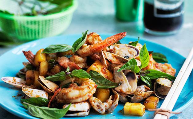 Stir-fried prawns and pipis in spicy sauce with pineapple