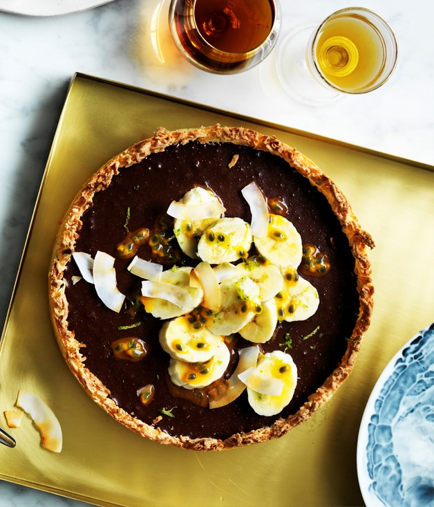 Chocolate coconut tart with passionfruit and banana