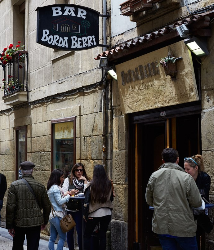 **Borda Berri exterior** It looks like a classic pintxos bar - a small, brightly lit, stand-up space - except there's no pintxos on the bar. The food is inventive, it's all cooked to order and it gets really rammed when they're busy. The house specialty is raciones - dishes roughly the size of a bread and butter plate - and they're served with cutlery, where a pintxo would normally be something you'd eat with your hands. They do a good pig's ear with chimichurri (or, as they call it, tximitxurri), an outstanding raviolo of wild mushrooms on mushroom sauce, and they're also very well known for their veal cheek. They cook it in a mirepoix with Pedro Ximénez for hours, then they blitz that mirepoix into a sauce and pour it on top. These guys' small plates might well be the best quality in the Old Town.  _Calle Fermin Calbeton 12, +34 94 343 0342_