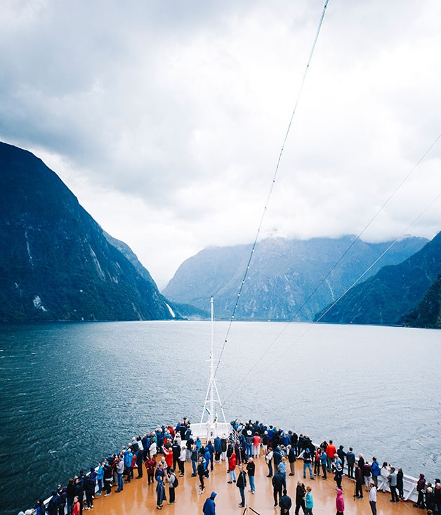 **Holland America Cruise Line** Gliding through New Zealand's majestic Milford Sound.  Photography by Chris Chen.