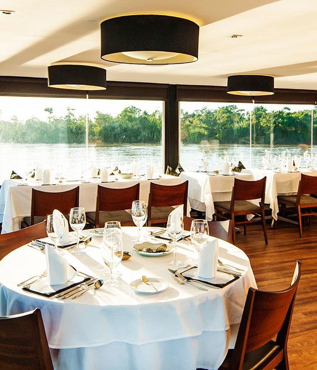 **Aqua Expeditions** Enjoy gourmet food prepared by Australian chef David Thompson in the Amazon dining room on board the Aqua Mekong.