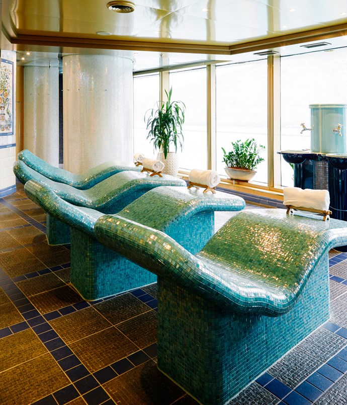 **The turquoise-tiled heated daybeds in the Greenhouse Spa & Salon**