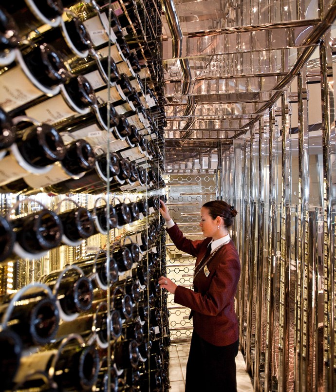 **Celebrity Cruises** A Celebrity Cruises sommelier selecting wine.  Photography by Nassima Rothacker.