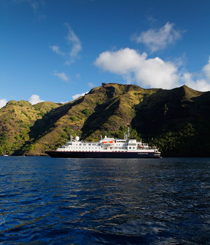 **Silversea** Silversea's _Silver Discoverer_ anchored off Fatu Hiva, the southernmost of the Marquesas Islands in French Polynesia.  Photography by Julian Kingma.